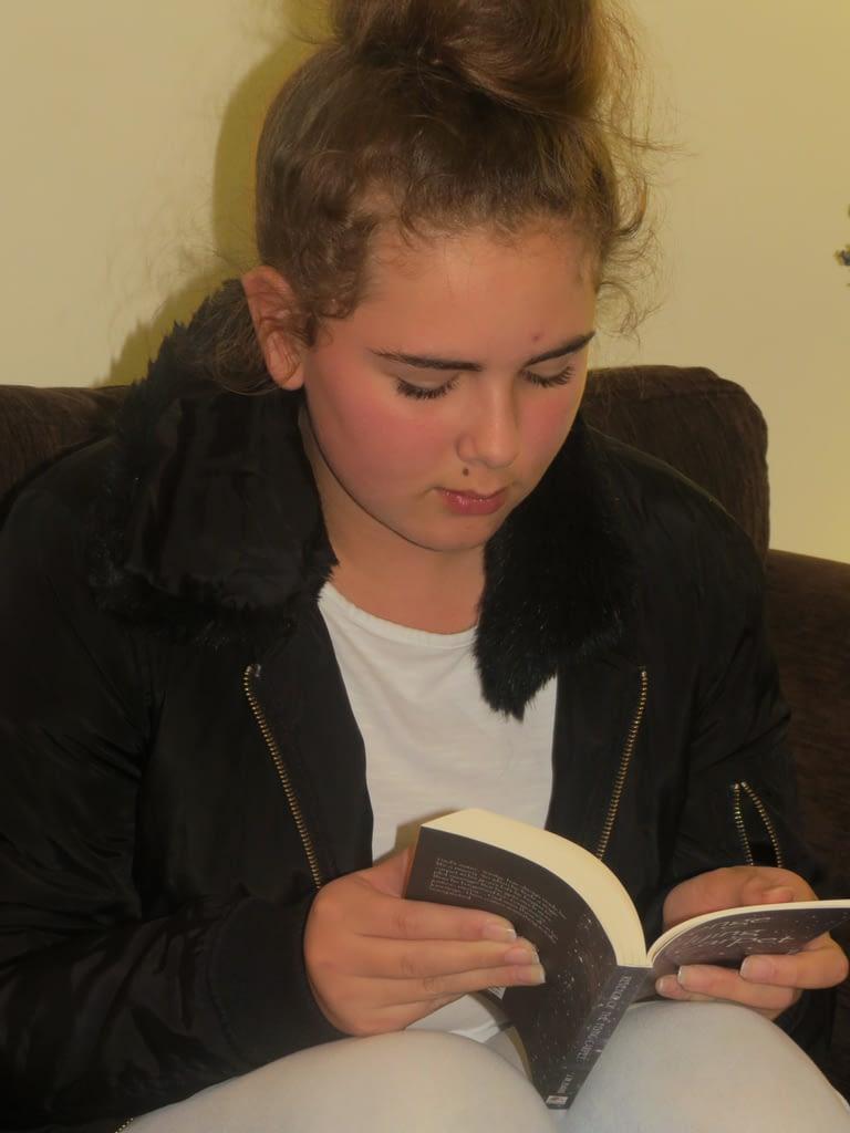 Girl reading Revenge of the Flying Carpet