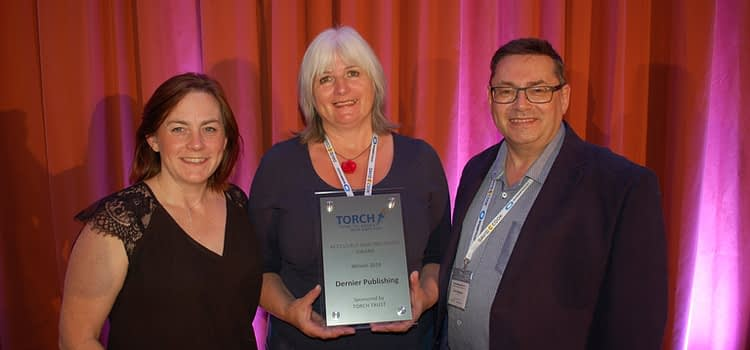 Janet Wilson of Dernier Publishing, accepting the Accessible and Inclusive award from Torch Trust.