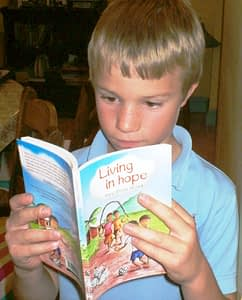 Boy reading Christian book