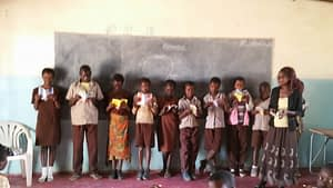 Children from Zambian school with Dernier Publishing books