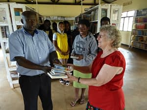 Mary Weeks Millard giving Christian books to Star School, Rwanda