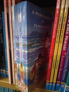 Dernier books on bookshelf