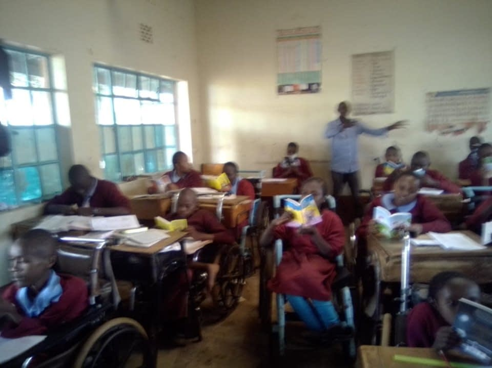 Children with disabilities reading books from Dernier Publishing