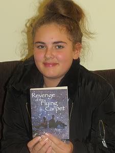 Girl holding Revenge of the Flying Carpet