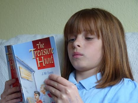 Girl reading The Treasure Hunt book